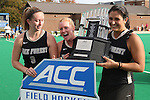 09 November 2014: Wake Forest captains Georgia Holland (9), Tyra Clemmenson (center), and Anna Kozniuk (CAN) (right) are presented with the ACC Championship Trophy. The Wake Forest University Demon Deacons played the Syracuse University Orange at Jack Katz Stadium in Durham, North Carolina in the 2014 Atlantic Coast Conference NCAA Division I Field Hockey Championship Game. Wake Forest won the ACC Championship game 2-0.