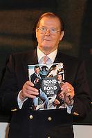 London - Sir Roger Moore signs his book 'Bond on Bond' at HMV Oxford Street, London - October 22nd 2012..Photo by Bob Kent