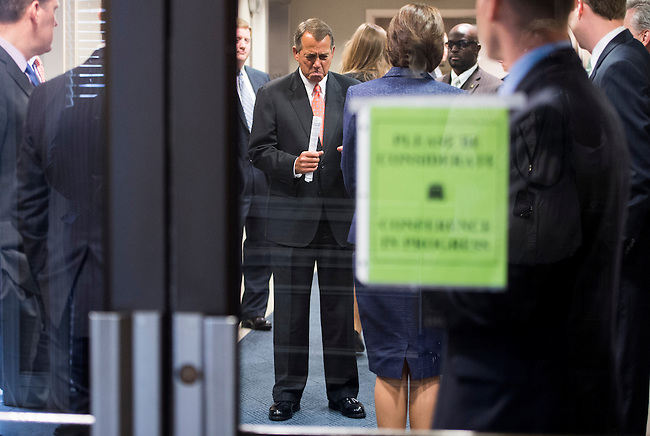 Speaker of the House John Boehner, R-Ohio, speaks with House GOP leaders and staff before heading to the podium for the media availability immediately after the House Republican Conference meeting at Republican National Committee headquarters on Capitol Hill on Tuesday, April 16, 2013.