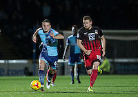 Stephen McGinn of Wycombe Wanderers heads forward alongside Jack McBean of Coventry City during the The Checkatrade Trophy Southern Group D match between Wycombe Wanderers and Coventry City at Adams Park, High Wycombe, England on 9 November 2016. Photo by Andy Rowland.