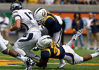 California defenders' Alex Logan and Robert Mullins sack Nevada quarterback Cody Fajardo during the game at Memorial Stadium in Berkeley, California on September 1st, 2012.  Nevada Wolf Pack defeated California, 31-24.