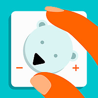 Hand turning down polar bear central heating thermostat