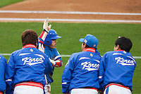 21 March 2009: #15 Yong-Kyu Lee of Korea celebrates with teammates after scoring on a single by #50 Hyun-Soo Kim during the 2009 World Baseball Classic semifinal game at Dodger Stadium in Los Angeles, California, USA. Korea wins 10-2 over Venezuela.