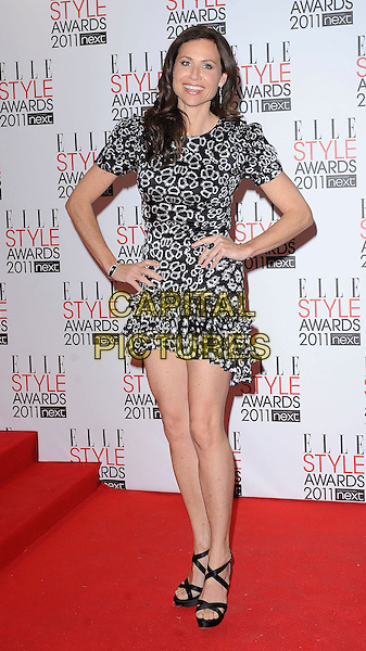 MINNIE DRIVER .2011 ELLE Style Awards at the Grand Connaught Rooms, London, England, UK, February 14th, 2011..full length  white  dress black print ruffle hem hands on hips strappy  sandals .CAP/BEL.©Tom Belcher/Capital Pictures.