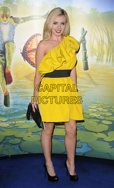 "KATHERINE JENKINS .At the Cirque du Soleil ""Totem"" press Tour, Royal Albert Hall, Kensignton Gore, London, 5th January 2011..Full length yellow ruffle dress black waistband shoes platform clutch bag .CAP/CAN.©Can Nguyen/Capital Pictures."
