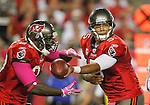 Tampa Bay Buccaneers quarterback Josh Freeman (5) ands off to Tampa Bay Buccaneers running back LeGarrette Blount (27) in a game against the Indianapolis Colts.  The Buccaneers defeated the Colts 24-17 in an NFL game, Monday, Oct. 3, 2011 in Tampa, Fla. (AP Photo/Margaret Bowles)