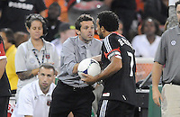 D.C. United head coach Ben Olsen congratulates Dwayne De Rosario on his 100th career goal. The New York Red Bulls tied D.C. United 2-2 at RFK Stadium, Wednesday August 29, 2012.