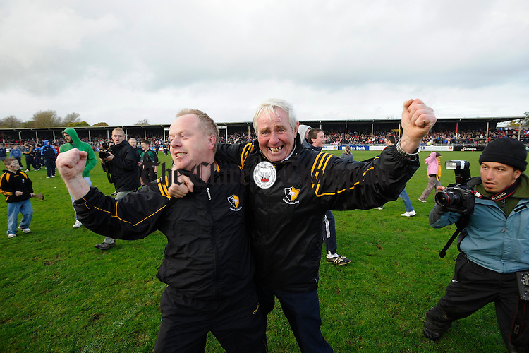 Clonlara manager Jim Gully and club chairman Michael Hogan celebrate following their senior county final victory at Cusack Park. Photograph by John Kelly.