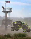 Joe Mueller flies past the flag stand during the Buffalo Chip 100 off-road racing event Saturday at the T.O.R.C. track in Sturgis, S.D.  (Photo by Richard Carlson/Inertia)