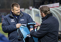 Wycombe Wanderers Chairman Andrew Howard hands BBC Presenter Bill Turnbull a signed shirt during the Sky Bet League 2 match between Wycombe Wanderers and Exeter City at Adams Park, High Wycombe, England on 13 February 2016. Photo by Kevin Prescod.
