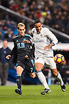 Danilo Luiz Da Silva of Real Madrid fights for the ball with Juanmi Jimenez of Real Sociedad during their La Liga match between Real Madrid and Real Sociedad at the Santiago Bernabeu Stadium on 29 January 2017 in Madrid, Spain. Photo by Diego Gonzalez Souto / Power Sport Images