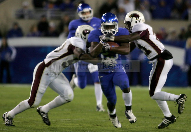 UK tailback Derrick Locke pushes through two Warhawks during the second half of the UK vs. Louisiana Monroe game at Commonwealth Stadium on Saturday, Oct. 24, 2009. The Wildcats beat the Warhawks 36-13. Photo by Adam Wolffbrandt | Staff