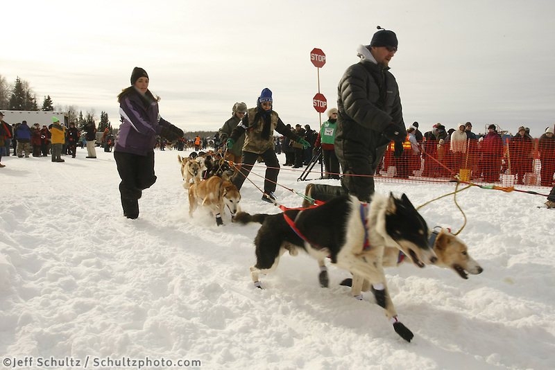 Ray Redington Jr. handlers walk the dogs to the start line on Sunday during the restart day of Iditarod 2009 in Willow , Alaska