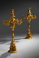 BNPS.co.uk (01202 558833)<br /> Pic: Woolley&Wallis/BNPS<br /> <br /> Mon Dieu ! - Royal French candelabra catch light at Woolley & Wallis auctioneers in Salisbury.<br /> <br /> Ornate candlesticks that were liberated by an angry French mob from the Duke of Orlean's luxurious Tuileries Palace during the 1848 revolution sold for £125,000 yesterday - over 4 times their estimate.<br /> <br /> The matching pair were sold off to British industriallist Sir James Watts 170 years ago, and had not been seen since.<br /> <br /> Salisbury auctioneers Woolley & Wallis were selling the spectacular ornaments with a conservative £30,000 estimate.<br /> <br /> The 3ft tall gilt bronze candelabra were created in 1839 when they were made for Ferdinand Philippe, Duke of Orléans and the eldest son of King Louis Philippe I.
