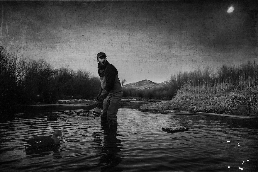 Nick Romano, of Bozeman, Montana, sets decoys while waterfowl hunting on the Beaverhead River near Dillon, Montana.