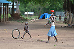 A woman and her son walk through a camp for more than 5,000 displaced people in Riimenze, in South Sudan's Gbudwe State, what was formerly Western Equatoria. Families here were displaced at the beginning of 2017, as fighting between government soldiers and rebels escalated.<br /> <br /> Two Catholic groups, Caritas Austria and Solidarity with South Sudan, have played key roles in assuring that the displaced families here have food, shelter and water.<br /> The camp formed around the Catholic Church in Riimenze as people fled violence in nearby villages for what they perceived as the safety offered by the church.