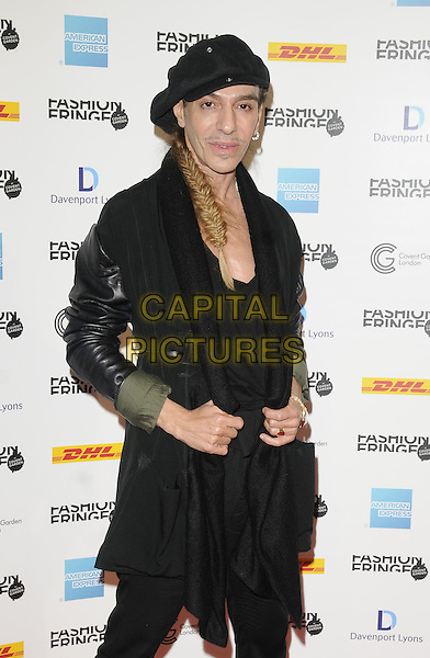 JOHN GALLIANO.At the Fashion Fringe show during Day 2 of London Fashion Week, Covent Garden, London, England, UK, September 18th 2010..LFW half ength black hat cap scarf leather coat jacket trousers plaid hair fishtail braid .CAP/CAN.©Can Nguyen/Capital Pictures