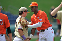 Center fielder Kyle Lewis (20) of the Mercer Bears shakes hands with Matt Smith (17) after winning a SoCon Tournament game against Western Carolina on Saturday, May 28, 2016, at Fluor Field at the West End in Greenville, South Carolina. Mercer won, 9-8. (Tom Priddy/Four Seam Images)