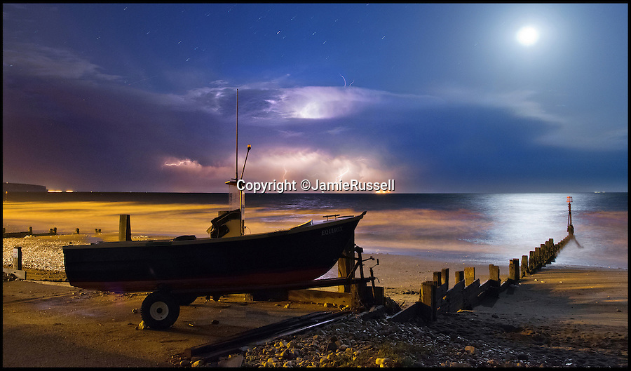 BNPS.co.uk (01202 558833)<br /> Pic: JamieRussell/BNPS<br /> <br /> ***Please Use Full Byline***<br /> <br /> A midnight storm over Shanklin beach.<br /> <br /> Stunning photographs have revealed a turbulent side to the normally genteel Isle of Wight.<br /> <br /> The seemingly benign south coast holiday destination has been catalogued over a stormy year by local photographer Jamie Russell, and his astonishing pictures reveal the dramatic changes in weather that roll across the UK in just 12 months.<br /> <br /> Lightning storms, ice, floods, gales and blizzards have all been captured by the intrepid photographer who frequently got up in the middle of the night to capture the climatic chaos.<br /> <br /> Looking at these pictures prospective holidaymakers could be forgiven for thinking twice about a gentle staycation on the south coast island.