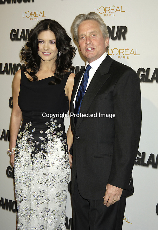 Catherine Zeta-Jones and husband Michael Douglas..at The Glamour Magazine  2005 Women of the Year Awards on November 2, 2005 at Lincoln Center's Avery Fisher Hall...Photo by Robin Platzer, Twin Images