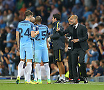 Josep Guardiola manager of Manchester City talks tp John Stones of Manchester City during the UEFA Champions League Group C match at The Etihad Stadium, Manchester. Picture date: September 14th, 2016. Pic Simon Bellis/Sportimage