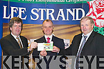DRAW: Drawing the winning ticket in the Lee Strand 5,000 draw on Friday morning at Lee Strand Headquarters, Ballymullen, Tralee were, l-r: Tim O'Keeffe (Financial Controller), Superintendent Pat Sullivan and Bill Kennedy (Manager Lee Strand)..