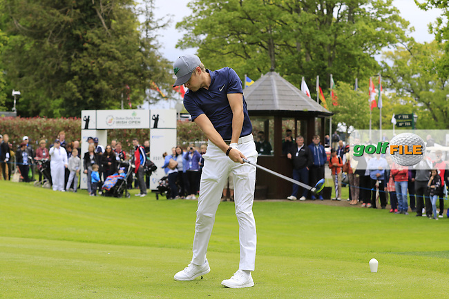 Niall Horan tees off the 1st tee during Wednesday's Pro-Am of the 2016 Dubai Duty Free Irish Open hosted by Rory Foundation held at the K Club, Straffan, Co.Kildare, Ireland. 18th May 2016.<br /> Picture: Eoin Clarke | Golffile<br /> <br /> <br /> All photos usage must carry mandatory copyright credit (&copy; Golffile | Eoin Clarke)