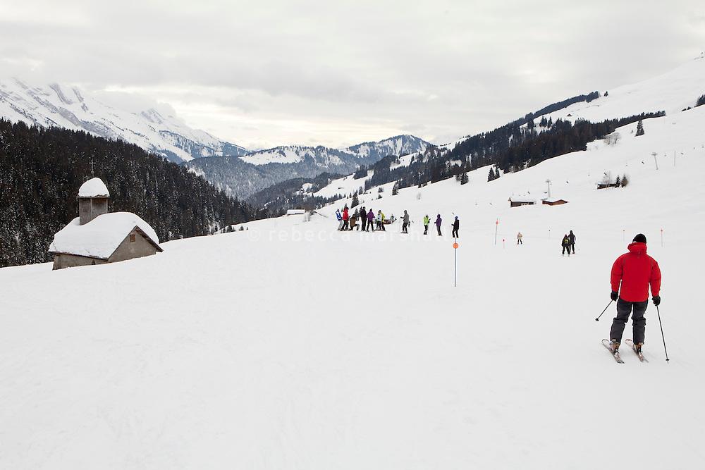 'La Duche' ski run, near Le Grand Bornand, France, 14 February 2012. The 17th century Chapelle de la Duche can be seen on the left.