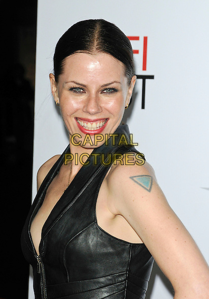 "FAIRUZA BALK.Arriving at the AFI Fest Screening of ""Bad Lieutenant: Port Of Call New Orleans"" at Grauman's Chinese Theatre in Hollywood, California, USA,.November 4th 2009..portrait headshot smiling black leather necklace hand greasy shiny skin oily face hair up zip tattoo eye contact .CAP/ROT.©Lee Roth/Capital Pictures"