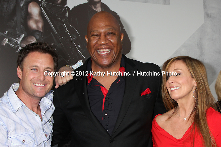 """Los Angeles - AUG 15:  Chris Harrison, Tiny Lister & guest arrives at the """"The Expendables 2""""  Premiere at Graumans Chinese Theater on August 15, 2012 in Los Angeles, CA"""