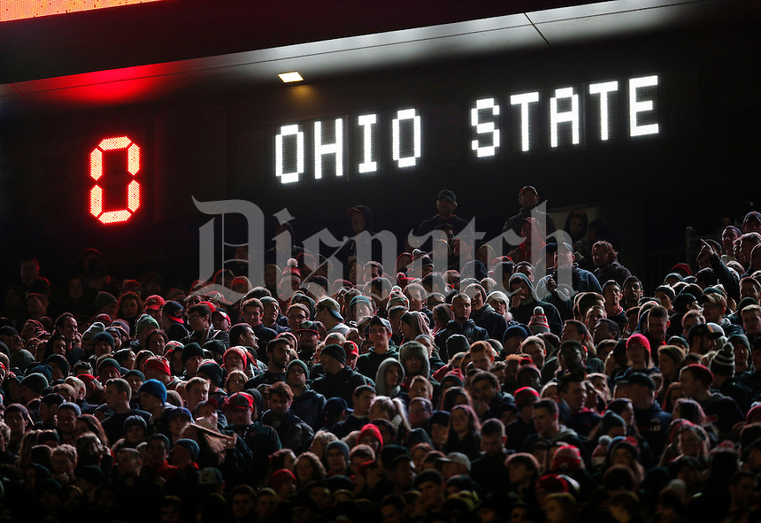 Ohio State fans watch the Buckeyes during the first half of the NCAA football game against the Penn State Nittany Lions at Ohio Stadium in Columbus on Oct. 17, 2015. Ohio State won 38-10. (Adam Cairns / The Columbus Dispatch)