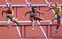 03 AUG 2012 - LONDON, GBR - Louise Hazel (GBR) (centre) of Great Britain clears a hurdle during her heat in the women's heptathlon at the London 2012 Olympic Games athletics in the Olympic Stadium in the Olympic Park in Stratford, London, Great Britain .(PHOTO (C) 2012 NIGEL FARROW)