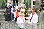Katie O'Connell, receives the Killarney Rotary Clubs presidents chain of Office from outgoing president Sean Tracey in the Malton Hotel, Killarney on Wednesday. Also pictured are Martin Lucey, Grace O'Neill, Angela O'Connor, Katie Phelan, Shauna Corcoran, Ciara Irwin Foley, Edel Heenan, Tom Leslie, Barry Murphy, Rory Healy, Finbarr Kennelly, Michael Stack, Eduard Schmidt Zorner, Conor Griffin, James Tarrant and John O'Sullivan...............................................................................................