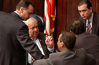 TALLAHASSEE, FL. 4/24/03-Senate President Jim King, R-Jacksonville, seated center, listens to Sens. Tom Lee, R-Brandon, left, Alex Villalobos, R-Miami, Ron Klein, D-Delray Beach and Alex Diaz de la Portilla, R-Miami, right, as they talk over a budget issue Thursday at the Capitol in Tallahassee. The House and Senate are still negotiating the budget. COLIN HACKLEY PHOTO