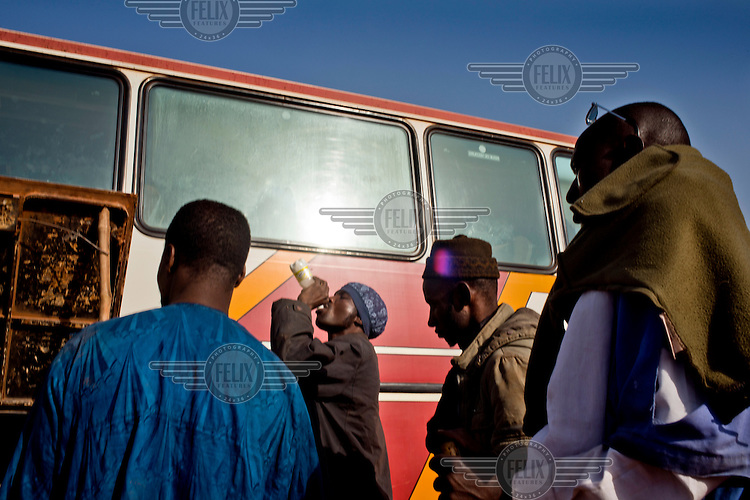 Travellers boarding a bus heading north to Mopti.