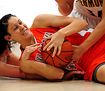 13 December 2009: Oklahoma State University Cowgirls' forward Tegan Cunningham, a Senior from Melbourne, Australia, holds onto the ball after being fouled during a game against the University of Vermont Catamounts at Patrick Gymnasium in Burlington, Vermont. The Lady Cats were unable to hold onto a second half lead, falling to the Cowgirls 68-63. Mandatory Credit: Ed Wolfstein Photo