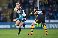 Joe Carlisle of Worcester Warriors looks to go round Tommy Bell of London Wasps during the LV= Cup second round match between London Wasps and Worcester Warriors at Adams Park on Sunday 18th November 2012 (Photo by Rob Munro)