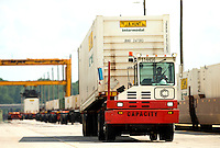 Photography of the Norfolk Southern's Intermodal Facility in Charlotte, NC. The Charlotte Regional Intermodal Facility at CLT is 170-acre site between two runways at Charlotte Douglas International Airport. The new yard has a current capacity for 140,000 containers a year, and it could expand to 200,000.The intermodal hub links air, rail and truck to east coast seaports. <br /> <br /> Charlotte Photographer - PatrickSchneiderPhoto.com