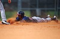 Atlanta Braves Cristian Pache (94) slides into second base during an Instructional League game against the Houston Astros on September 26, 2016 at Osceola County Stadium Complex in Kissimmee, Florida.  (Mike Janes/Four Seam Images)