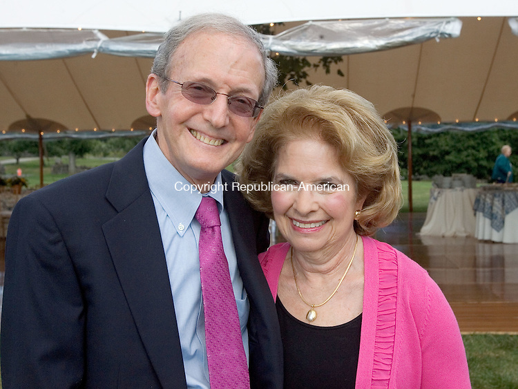 MIDDLEBURY CT. 24 August 2014-082414SV14-From left, Dr. Richard and Paula Getnick of Middlebury attend a sunset garden party at the Whittemore estate in Middlebury Sunday. The event was for The Mattatuck Museum.<br /> Steven Valenti Republican-American