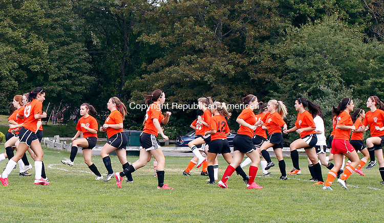 Watertown, CT- 02, September 2011-090211CM01  The returning NVL girls soccer champs, Watertown high school warm up before practice at Veteran's Memorial Park in Watertown Friday afternoon.  The team will be lead by returning head coach, Lisa Mariano.  Christopher Massa Republican-American
