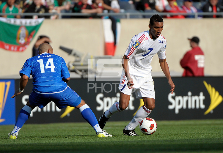 Cuba's Marcel Hernadez dribbles away from El Salvador's Dennis Alas.  El Salvador defeated Cuba 6-1 at the 2011 CONCACAF Gold Cup at Soldier Field in Chicago, IL on June 12, 2011.