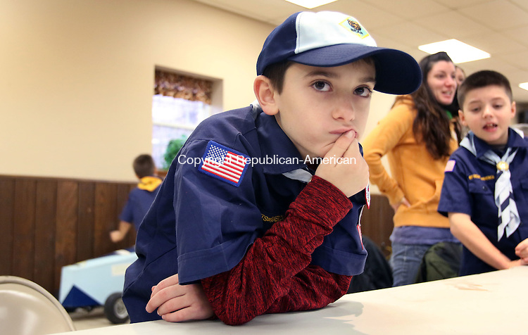 BETHLEHEM CT. 16 January 2015-011616SV02-Jeffrey Bernardi, 9, of Bethlehem watches his car race during the Boy Scouts Pinewood Derby in Bethlehem Saturday.<br /> Steven Valenti Republican-American