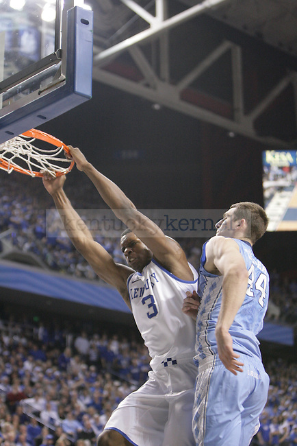 UK forward Terrence Jones dunks while being defended by North Carolina forward Tyler Zeller during the first half of UK's home game against North Carolina at Rupp Arena in Lexington, Ky., Dec. 1, 2011. Photo by Brandon Goodwin