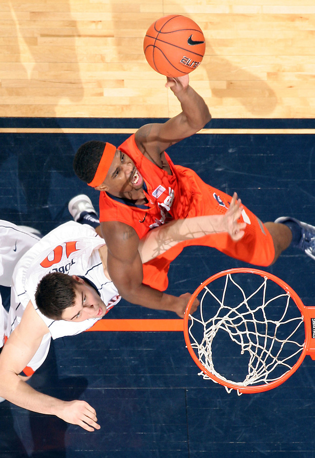 Syracuse forward C.J. Fair (5) shoots over Virginia forward/center Mike Tobey (10) during an NCAA basketball game Saturday March 1, 2014 in Charlottesville, VA. Virginia defeated Syracuse 75-56.