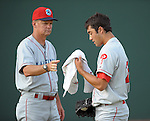 LHP Matthew Way (28) of the Lakewood BlueClaws gets a towel from pitching coach Steve Schrenk (55) while warming up for a game against the Greenville Drive on May 13, 2010, at Fluor Field at the West End in Greenville, S.C.