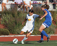 Western New York Flash forward Samantha Kerr (4) passes the ball as Boston Breakers defender Julie King (8) closes. In a National Women's Soccer League (NWSL) match, Boston Breakers (blue) tied Western New York Flash (white), 2-2, at Dilboy Stadium on August 3, 2013.
