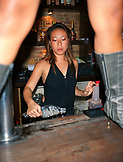 SINGAPORE, portrait of a female bartender holding ice cubes at CU Bar.