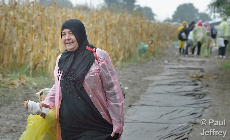 A refugee woman approaches the border into Croatia near the Serbian village of Berkasovo. Hundreds of thousands of refugees and migrants from Syria, Iraq and other countries have flowed through Serbia in 2015, on their way to western Europe.