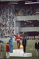 "July 30, 1976 - Montreal, Quebec, Canada: Bruce Jenner on podium receiving Gold mead, next to Guido Kratschmer of West Germany, Silver, and Mykola Avilov, bronze of the Soviet Union. At the 1976 Montreal Olympic games, US athlete Jenner won the gold medal in the decathlon, scoring 8,616 points, thereby beating his own world record set at the Olympic Trials. Jenner hit a ""home run"" by achieving personal bests on the first day, turning a notorious second day into a gold medal coronation. In an April 2015 interview, Jenner came out as a trans woman saying he / she had dealt with gender dysphoria since his / her youth, and that, for all intents and purposes, ""I?m a woman."""